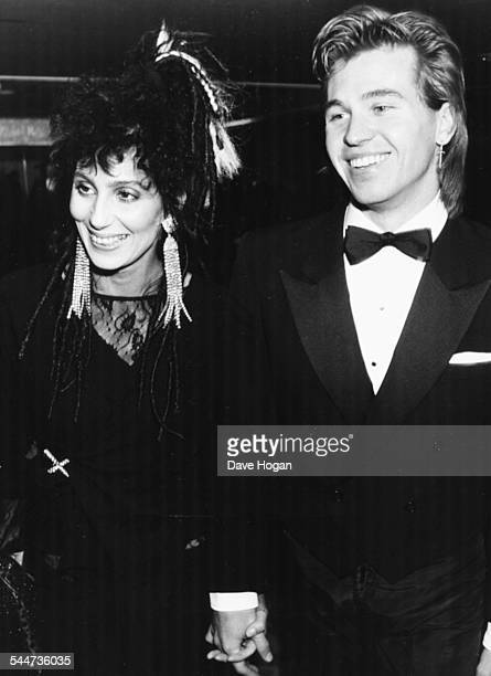 Singer Cher and actor Val Kilmer attending the BAFTA Awards hand in hand London March 25th 1984