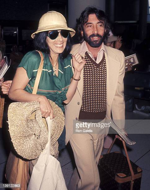 Singer Cher and celebrity manager Sandy Gallin on March 13 1977 arrive at the Los Angeles International Airport in Los Angeles California