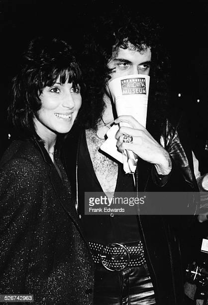 Singer Cher and musician Gene Simmons attending the premiere of the movie 'Kramer vs Kramer', December 1979.