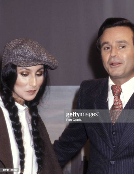 Singer Cher and talk show host Stanley Siegel on September 23 1977 take a break during taping of The Stanley Siegel Show at ABC Studios in New York...