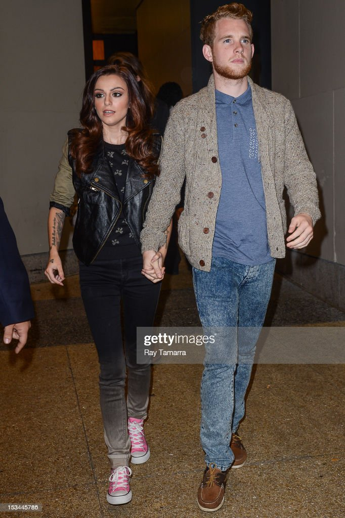 Singer Cher Lloyd (L) and hairdresser Craig Monk leave a Midtown Manhattan office building on October 5, 2012 in New York City.