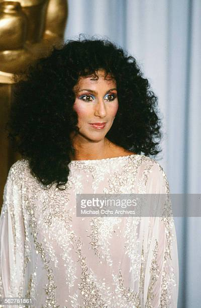 Singer Cher poses backstage during the 55th Academy Awards at Dorothy Chandler Pavilion Los Angeles California