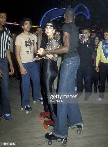Singer Cher roller skates at the Casablanca Record and Filmworks Roller Skating Party on February 26 1979 at the Empire Roller Disco Skating Rink in...