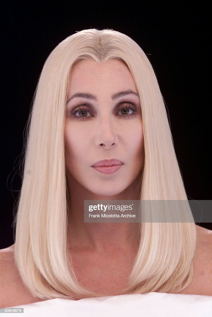 Singer Cher shoots the video for her new single, Song for the Lonely, from her upcoming CD 'Living Proof', due to be released in March 2002. With Cher are actors portraying different periods in New York City history, December 15th, 2001 in downtown Manahattan.
