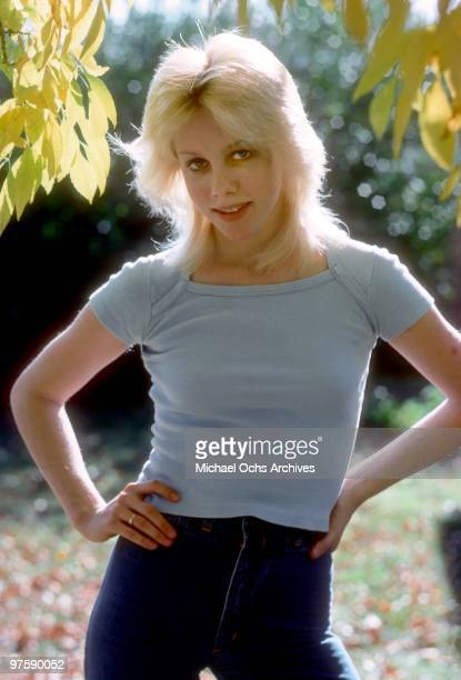 Singer Cherie Currie of the rock band 'The Runaways' poses for a portrait at her family's home in Encino in Los Angeles in December of 1976