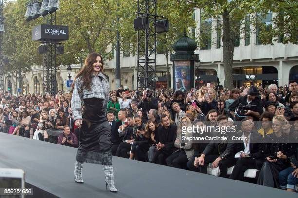 Singer Cheryl Cole walks the runway during the Le Defile L'Oreal Paris Spring Summer 2018 show as part of Paris Fashion Week at Avenue des...
