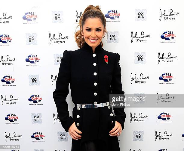 Singer Cheryl FernandezVersini poses ahead of The World Famous Oxford Street Christmas Lights Switch On Event taking place at John Lewis' Flagship...