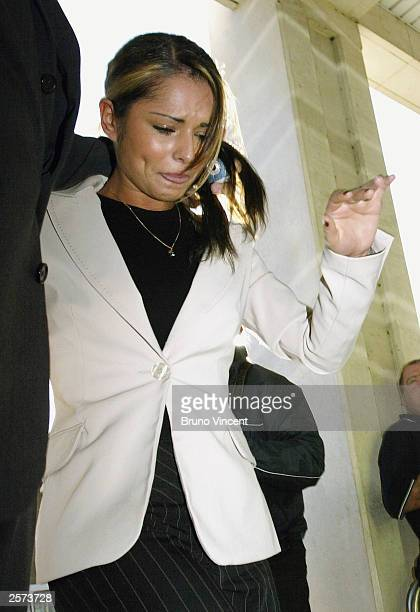 Singer Cheryl Tweedy arrives at Kingston Crown Court October 9 2003 in London She appears charged with racially aggravated assault after being...