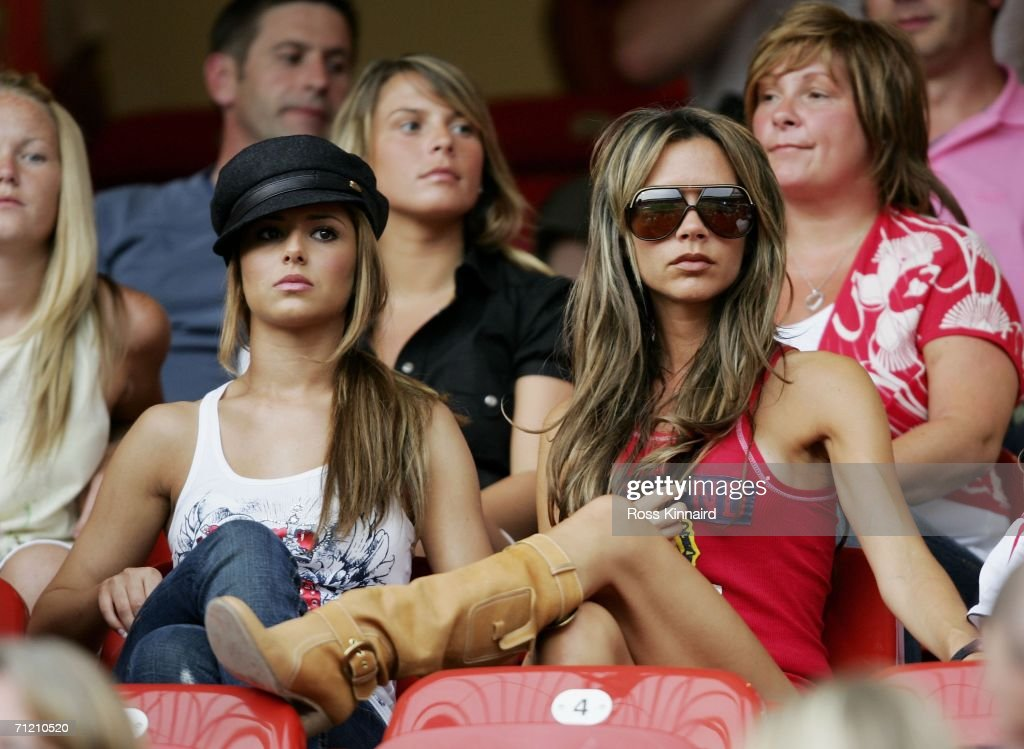Singer Cheryl Tweedy the girlfriend of Ashley Cole and Victoria Beckham the wife of England Captain David Beckham, attend the FIFA World Cup Germany 2006 Group B match between England and Trinidad and Tobago at the Frankenstadion on June 15, 2006 in Nuremberg, Germany.
