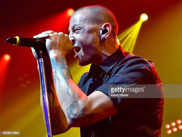Singer Chester Bennington performs onstage during the iHeartRadio album release party with Linkin Park presented by Clear Channel at the iHeartRadio...