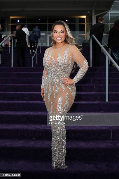 Singer Chiquis Rivera pose for picture during purple carpet of Premios de la Radio 2019 at Verizon Theater on November 7 2019 in Grand Prairie Texas