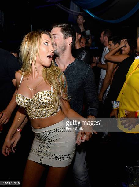 Singer Chloe Lattanzi and her fiance James Driskill dance during the celebration of the 35th anniversary of 'Xanadu' with the world premiere of their...