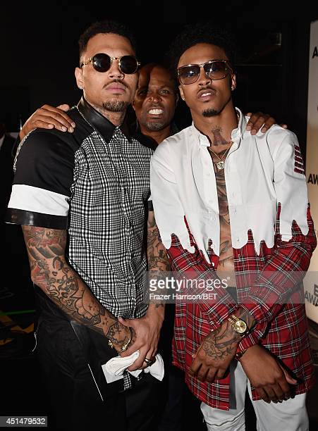 Singer Chris Brown and August Alsina pose backstage at the BET AWARDS '14 at Nokia Theatre LA LIVE on June 29 2014 in Los Angeles California