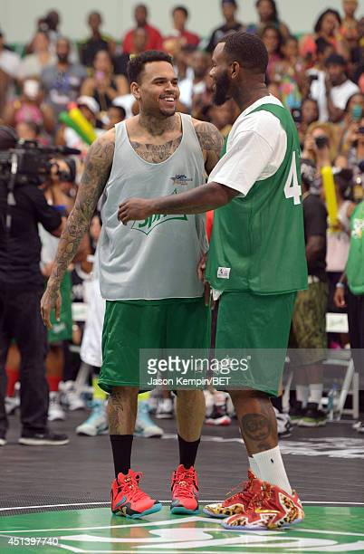 Singer Chris Brown and rapper The Game attend the Sprite Celebrity Basketball Game during the 2014 BET Experience At LA LIVE on June 28 2014 in Los...