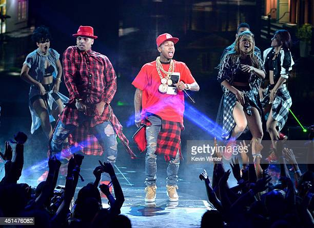 Singer Chris Brown and rapper Tyga perform onstage during the BET AWARDS '14 at Nokia Theatre LA LIVE on June 29 2014 in Los Angeles California