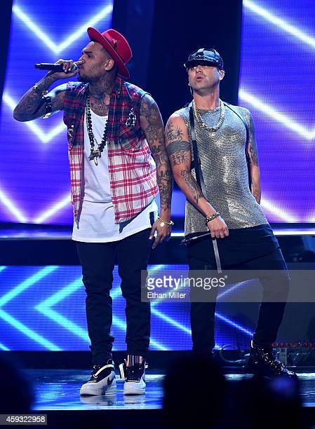 Singer Chris Brown and rapper Wisin perform onstage during the 15th Annual Latin GRAMMY Awards at the MGM Grand Garden Arena on November 20 2014 in...