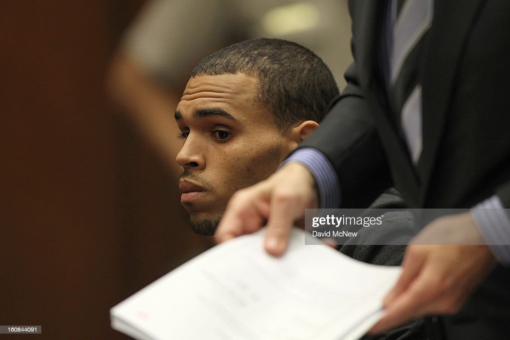 R&B singer Chris Brown appears in court for a probation progress report hearing as his attorney Mark Geragos holds documents he is discussing with the court on February 6, 2013 in Los Angeles, California. Brown pleaded guilty to assaulting his girlfriend, singer Rihanna, after a pre-Grammy Awards party in 2009. Prosecutors have alleged that he has failed to meet the terms of his probation.