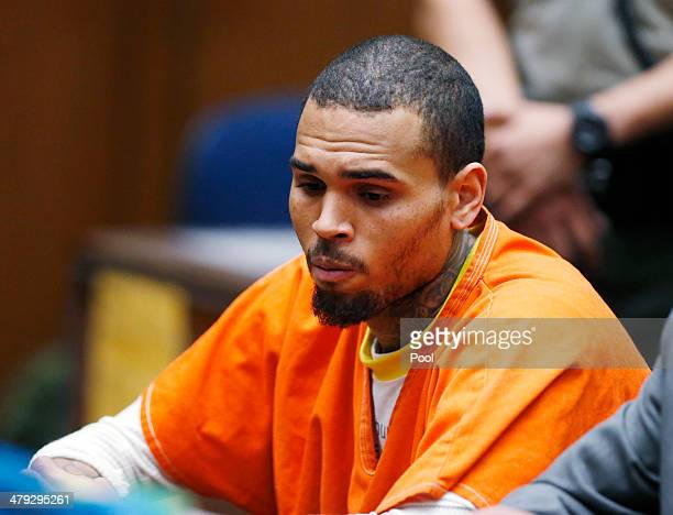 B singer Chris Brown appears in court for a probation violation hearing during in Los Angeles Superior on March 17 2014 in Los Angeles California The...
