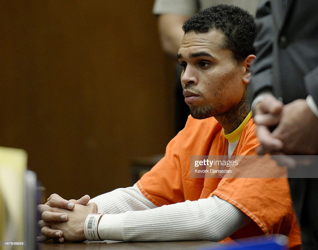 R&B singer Chris Brown appears in court for a probation violation hearing in Los Angeles Superior Court on May 1, 2014 in Los Angeles, California. Brown has been ordered to remain jailed without bail until another court hearing set for May 9. Brown has been on probation since pleading guilty to assaulting his then girlfriend, singer Rihanna, after a pre-Grammy Awards party in 2009. He has been in anger management treatment program and performing community service requirements. Brown and his bodyguard Christopher Hollosy are also facing misdemeanor simple assault charges after from an incident outside the W hotel in Washington D.C. last October.
