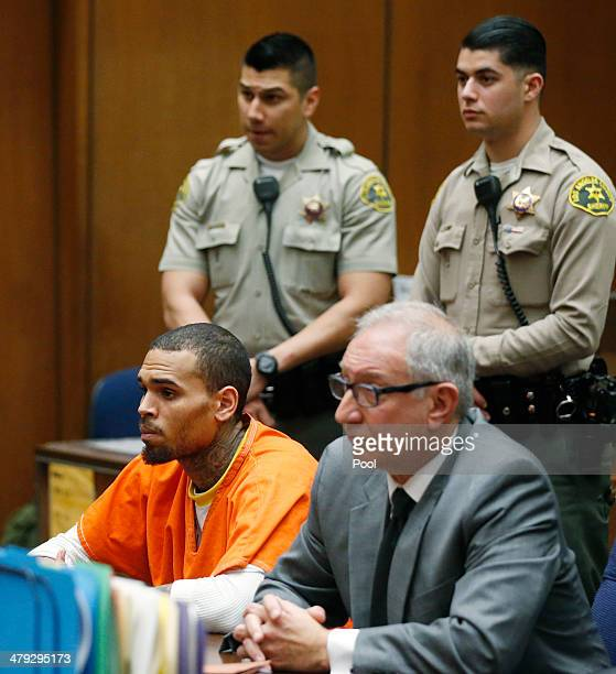 B singer Chris Brown appears in court with his attorney Mark Geragos for a probation violation hearing during in Los Angeles Superior judge on March...