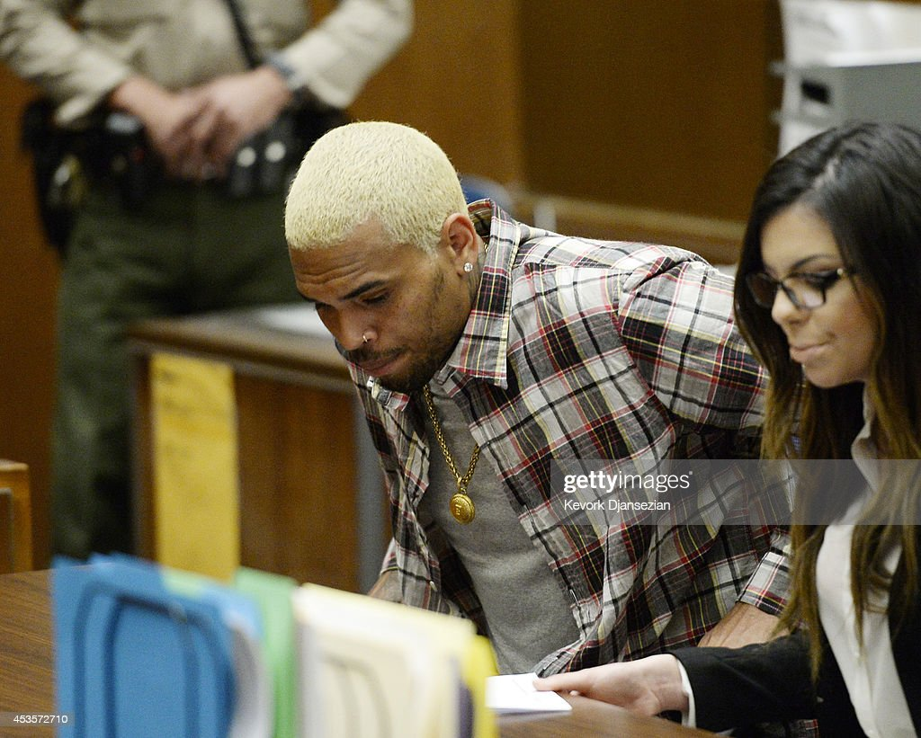 R&B singer Chris Brown appears in court with his lawyer Setara Qassim for a probation progress hearing in Los Angeles Superior Court on August 13, 2014 in Los Angeles, California.