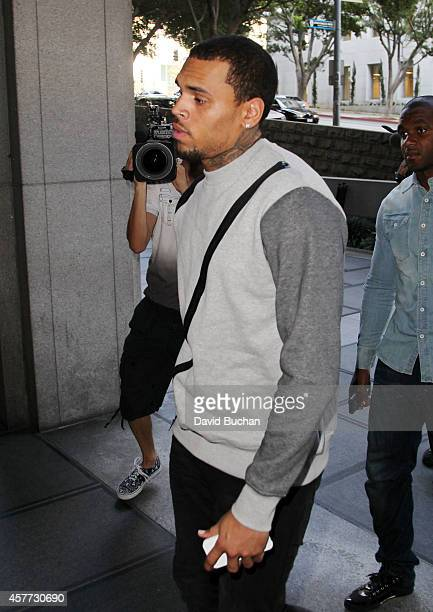 Singer Chris Brown attends a progress hearing at Los Angeles Superior Court on October 23 2014 in Los Angeles California Brown was first placed on...