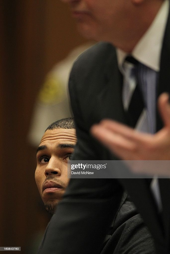R&B singer Chris Brown looks at attorney Mark Geragos as he appears in court for a probation progress report hearing on February 6, 2013 in Los Angeles, California. Brown pleaded guilty to assaulting his girlfriend, singer Rihanna, after a pre-Grammy Awards party in 2009. Prosecutors have alleged that he has failed to meet the terms of his probation.