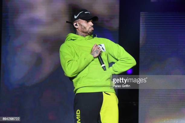 Singer Chris Brown performs onstage at 3rd Annual V103 Winterfest Concert at Philips Arena on December 16 2017 in Atlanta Georgia