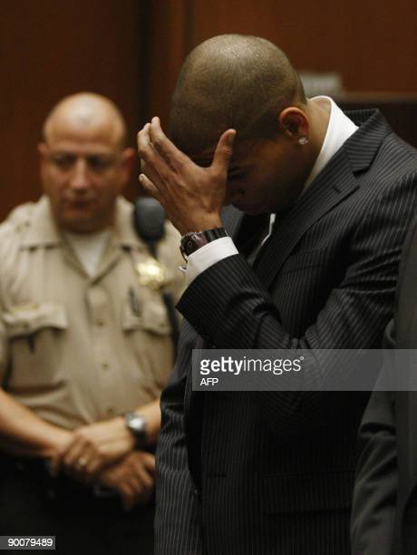 Singer Chris Brown reacts as he listens inside the Los Angeles Superior Court during sentencing in his felony assault case against Rihanna on August...