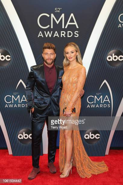 Singer Chris Lane and television personality Lauren Bushnell attend the 52nd annual CMA Awards at the Bridgestone Arena on November 14 2018 in...