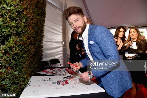 Singer Chris Lane attends the 2017 iHeartRadio Music Awards which broadcast live on Turner's TBS TNT and truTV at The Forum on March 5 2017 in...