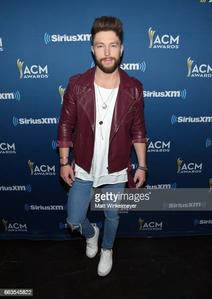 Singer Chris Lane poses at SiriusXM's The Highway Channel broadcasts leading up to the ACM Awards at TMobile Arena on April 1 2017 in Las Vegas Nevada