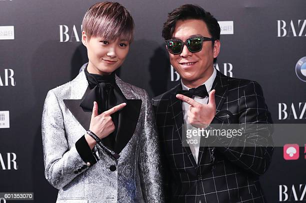 Singer Chris Lee and actor Huang Bo pose at red carpet of the 2016 Bazaar Star Charity Night on September 9 2016 in Beijing China
