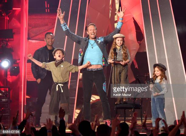 Singer Chris Martin of Coldplay accepts the Best Tour award from musician John Legend onstage at the 2017 iHeartRadio Music Awards which broadcast...