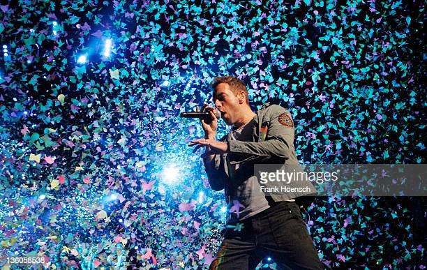 Singer Chris Martin of the band Coldplay performs live in concert during the Mylo Xyloto tour at the O2 World on December 21 2011 in Berlin Germany