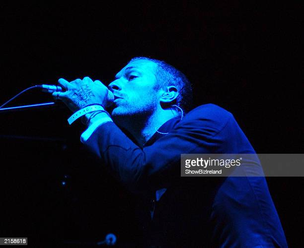 Singer Chris Martin of the rock group Coldplay performs at the Guinness Witnness Festival at Punchestown Racecourse July 12 2003 in Kildare Ireland