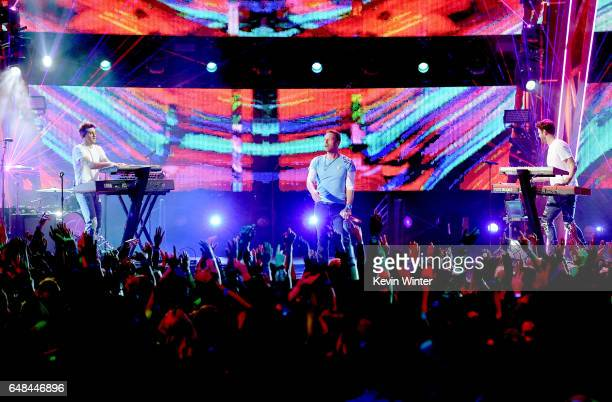 Singer Chris Martin performs with DJs Drew Taggart and Alex Pall of The Chainsmokers onstage at the 2017 iHeartRadio Music Awards which broadcast...