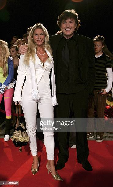 Singer Chris Roberts and wife Claudia Roberts arrive at the 50th Anniversary of Bravo Magazine at the Color Line Arena October 21 2006 in Hamburg...
