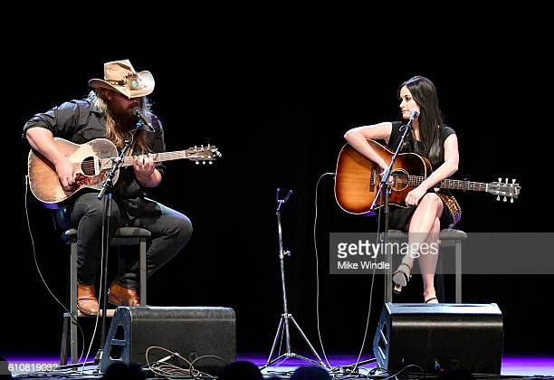 Singer Chris Stapleton and Singer Kacey Musgraves and Rock perform onstage during All For The Hall Los Angeles A benefit concert presented by The...