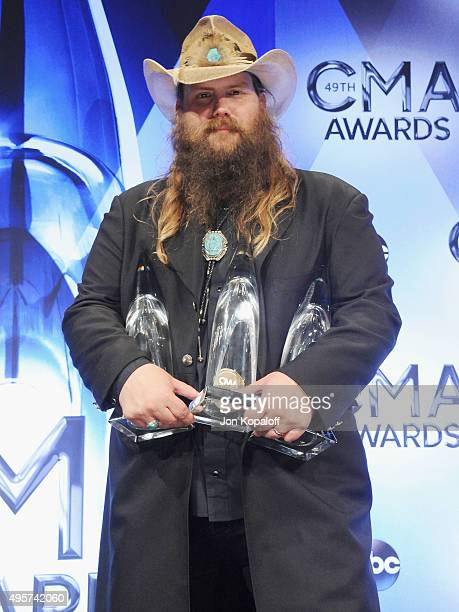 Singer Chris Stapleton poses in the press room at the 49th annual CMA Awards at the Bridgestone Arena on November 4 2015 in Nashville Tennessee