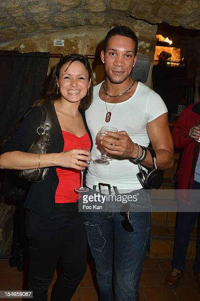 Singer Chris V and his wife attend the 'Les 10 Ans de Marc Mitonne' Party Hosted by '2 Mains Rouges' at the Marc Mitonne Restaurant on October 23...