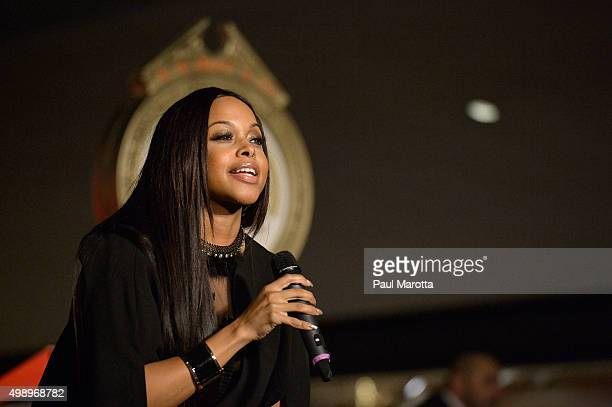 Singer Chrisette Michele performs at the annual Christmas tree lighting at Macy's Downtown Crossing on November 27 2015 in Boston Massachusetts