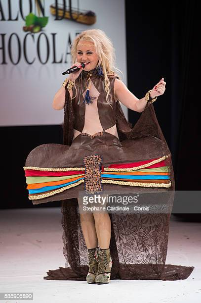 Singer Christelle Chollet walks the runway and wears 'Les Pouvoirs du Chocolat' a chocolate dress made by Wanderson Alves De Melo and chocolate brand...