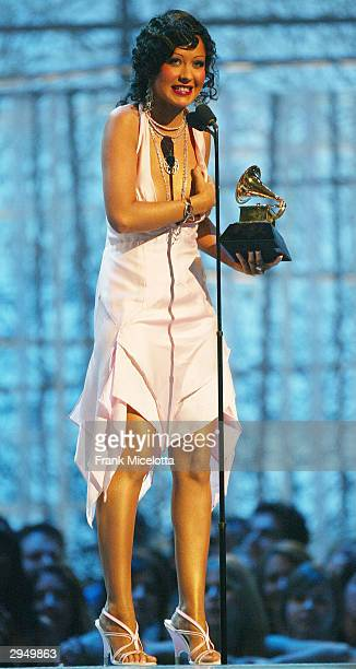 Singer Christina Aguilera accepts the Grammy for Best Female Pop Vocal Performance for the song 'Beautiful' on the album Stripped at the 46th Annual...