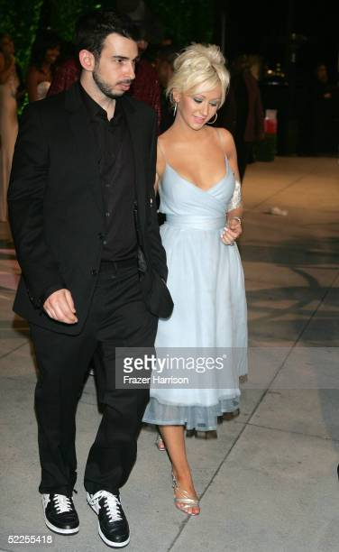Singer Christina Aguilera and her fiance Jordan Bratman arrive at the Vanity Fair Oscar Party at Mortons on February 27 2005 in West Hollywood...
