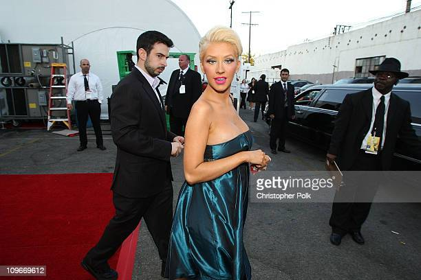 Singer Christina Aguilera and husband Jordan Bradman behind the scenes at the 59th Primetime EMMY Awards at the Shrine Auditorium on September 16...