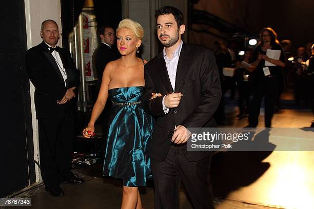 LOS ANGELES CA SEPTEMBER 16 Singer Christina Aguilera and husband Jordan Bratman behind the scenes at the 59th Primetime EMMY Awards at the Shrine...