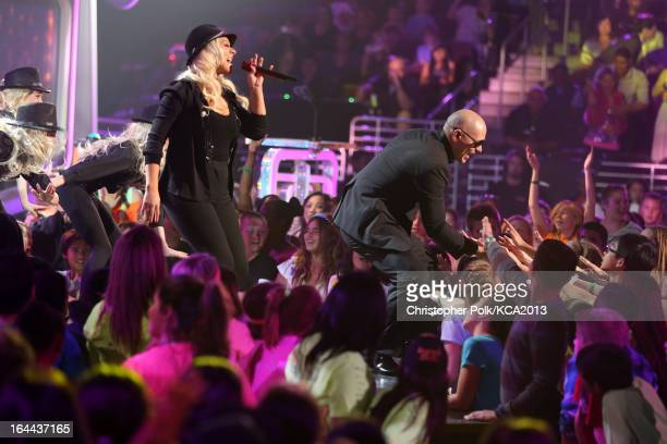 Singer Christina Aguilera and rapper Pitbull perform onstage during Nickelodeon's 26th Annual Kids' Choice Awards at USC Galen Center on March 23...