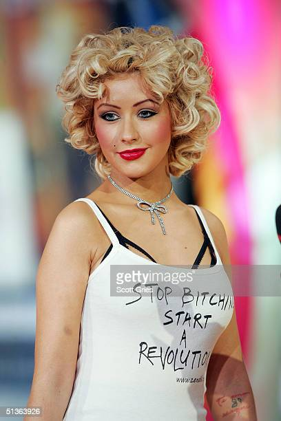 Singer Christina Aguilera appears on stage during MTV's Total Request Live at the MTV Times Square Studios September 27, 2004 in New York City.