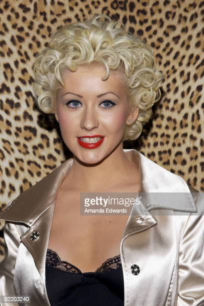 Singer Christina Aguilera arrives at the opening of Roberto Cavalli's new Rodeo Drive boutique on February 15 2005 in Beverly Hills California